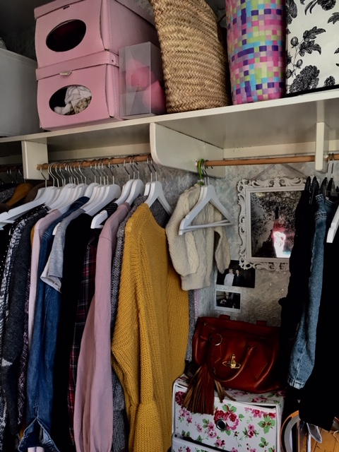 A shot of the 'work' side of my wardrobe... and a tiny jumper my Grandma knitted for me that hangs there,